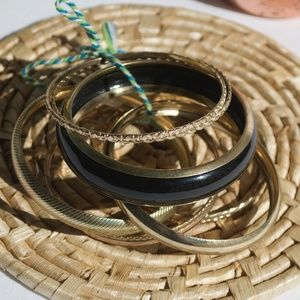 Set Of Black And Gold Bangles